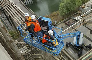 Workers on Genielift Lift